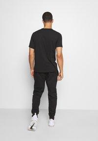 Champion - LEGACY CUFF PANTS - Teplákové kalhoty - black - 2