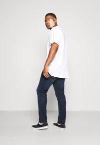 Levi's® Plus - 512 SLIM TAPER - Jeans Tapered Fit - brimstone adv - 2