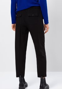 zero - RELAXED FIT - Tracksuit bottoms - black - 2