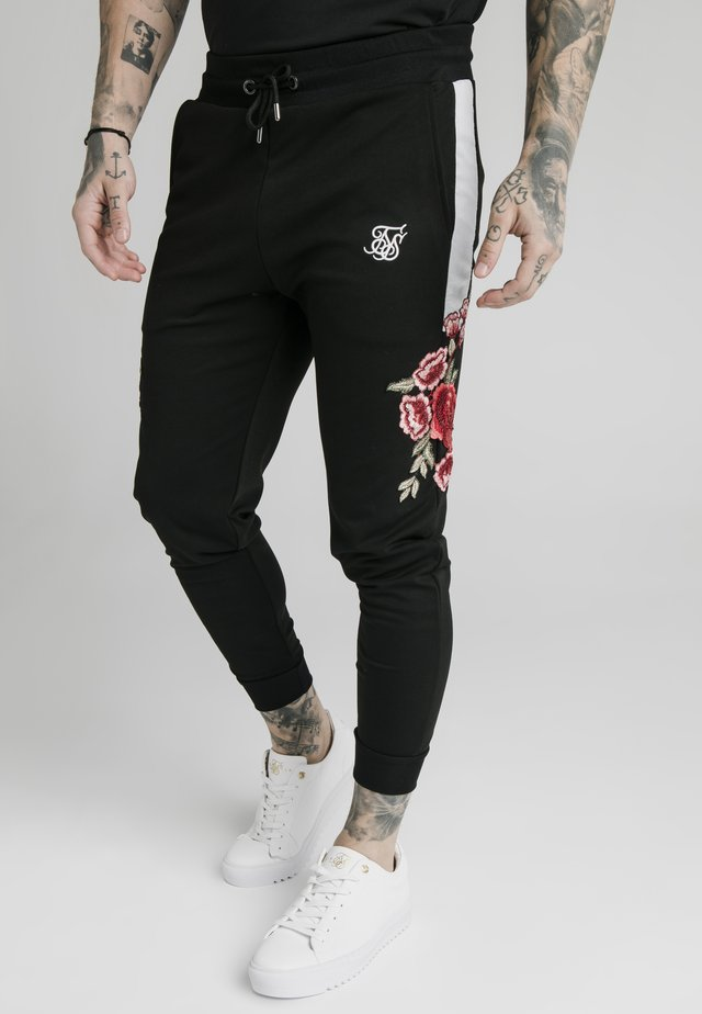 APPLIQUÉ PANELLED FITTED JOGGERS - Pantalon de survêtement - black