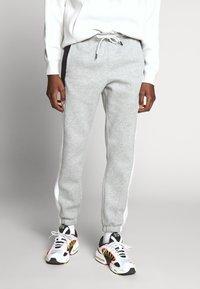 Nike Sportswear - Tracksuit bottoms - dark grey heather/white/black - 0