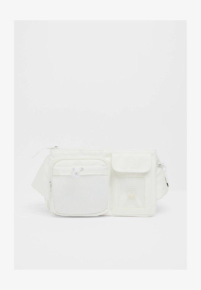 MULTIPOCKET - Sac banane - white