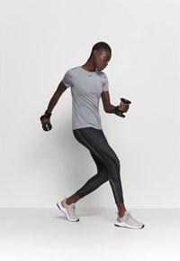 Nike Performance - ALL OVER - Camiseta básica - smoke grey/black - 1
