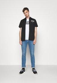 MOSCHINO - Print T-shirt - white - 1