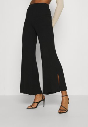FLARED PANTS - Tygbyxor - black