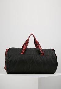 Puma - ESS BARREL BAG - Sports bag - black/pink alert - 2