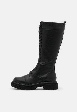 Plateaustøvler - black