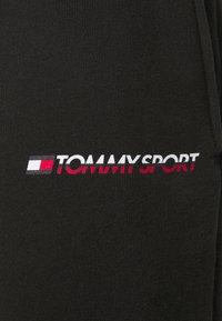 Tommy Hilfiger - LOGO - Spodnie treningowe - black - 6