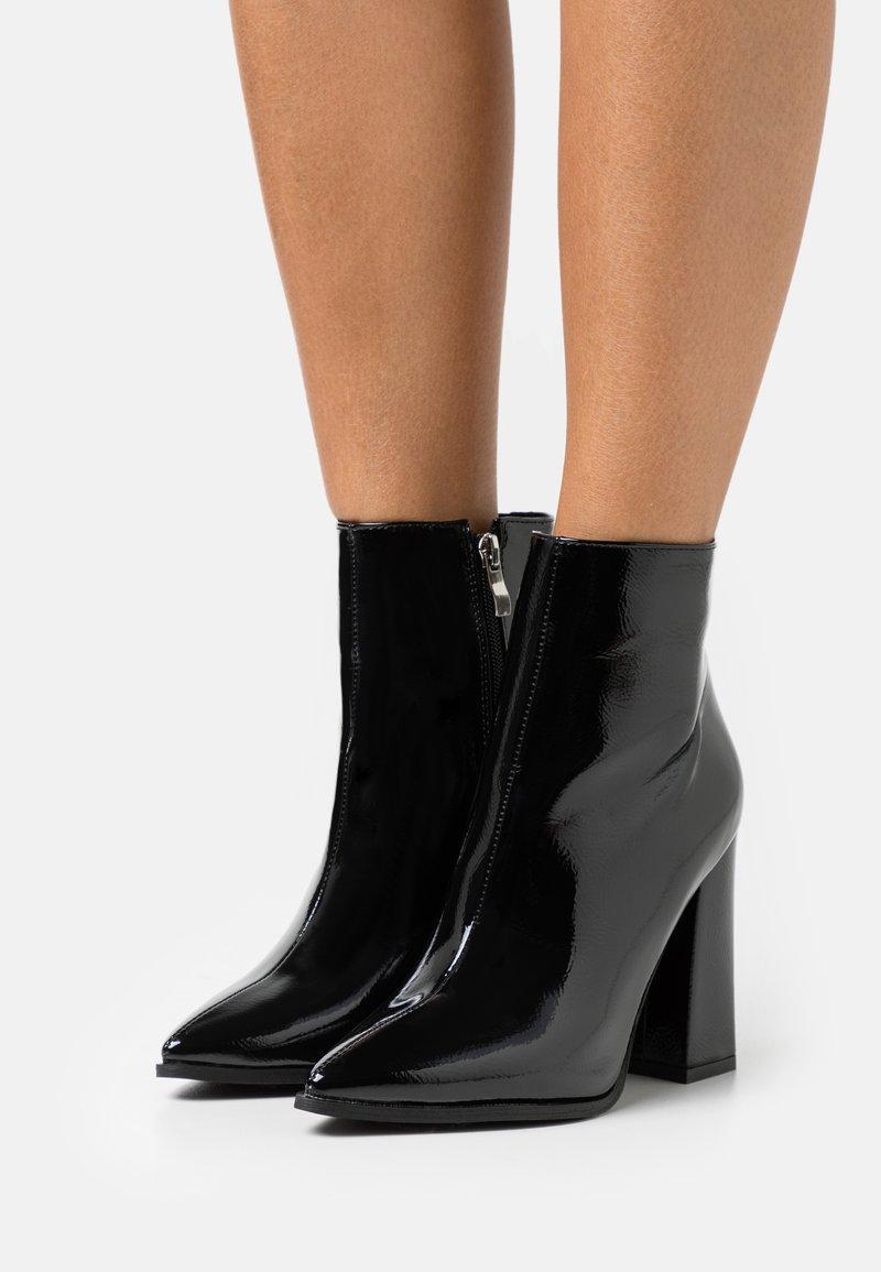 RAID - NEETA - Kotníková obuv na vysokém podpatku - black