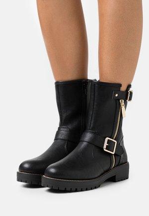 RENNI - Platform ankle boots - black