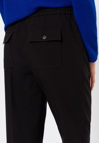 zero - RELAXED FIT - Tracksuit bottoms - black - 3
