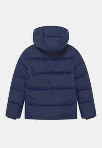 Calvin Klein Jeans - TAPE PUFFER - Winter jacket - peacoat - 1