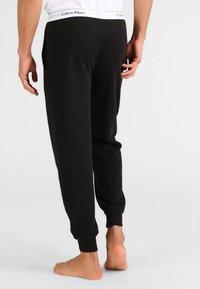 Calvin Klein Underwear - JOGGER - Pyjama bottoms - black - 2