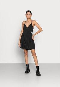 Calvin Klein Jeans - PLAYSUIT - Combinaison - black - 1