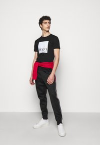 Polo Ralph Lauren - LUX TRACK - Tracksuit bottoms - black - 1