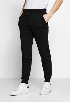 TROUSERS - Jogginghose - black