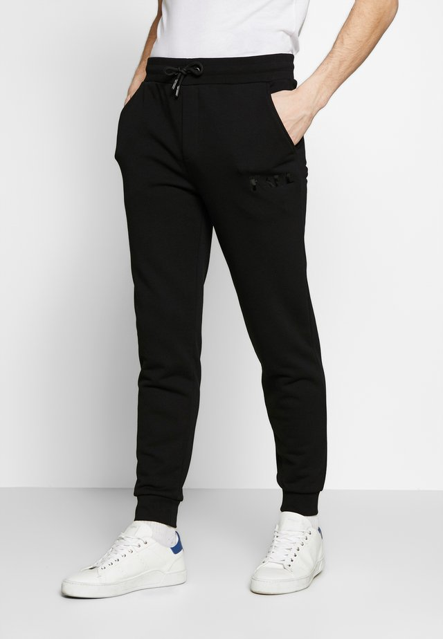 TROUSERS - Trainingsbroek - black