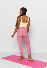 Nike Performance - YOGA CORE CUTOUT 7/8 - Leggings - desert berry/light arctic pink - 2