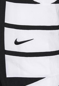 Nike Performance - STARTING PANT - Tracksuit bottoms - black/white - 5