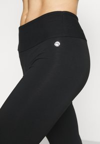 Deha - PANTS - Trainingsbroek - black - 4