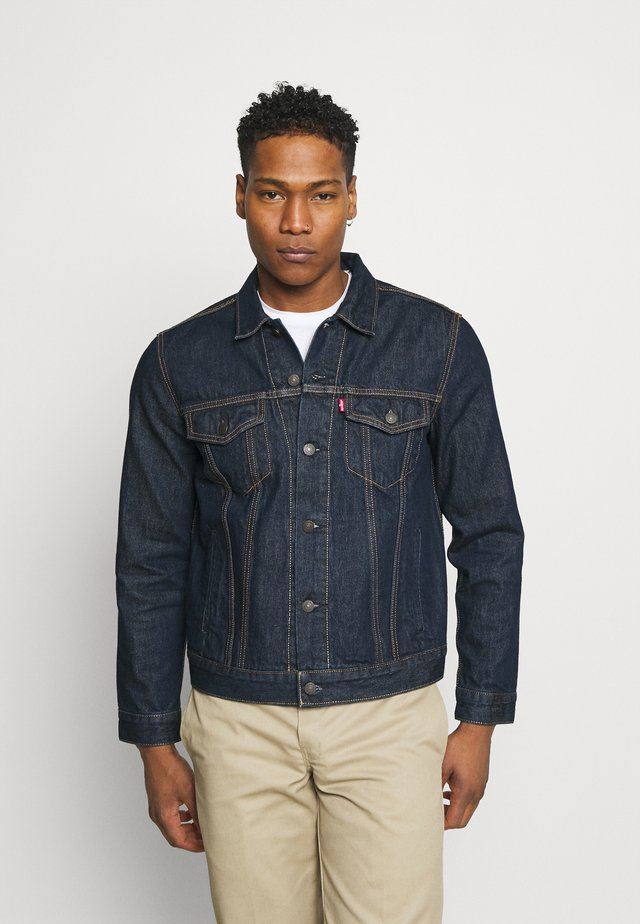 THE TRUCKER JACKET UNISEX - Veste en jean - med indigo