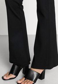 Vero Moda - VMKAMMA FLARED PANT - Trousers - black - 4