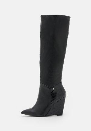 JINGLE - Laarzen met sleehak - black