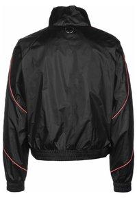 Puma - EVIDE JACKET - Waterproof jacket - black - 1