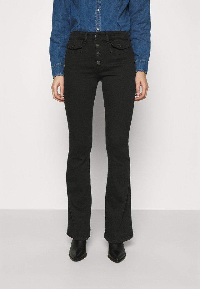 YOKO - Flared jeans - black