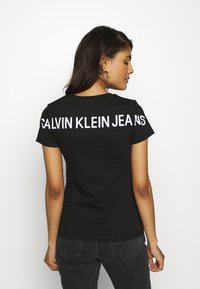 Calvin Klein Jeans - INSTITUTIONAL BACK LOGO TEE - Print T-shirt - black - 2