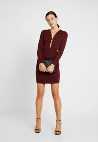Lost Ink - CUT OUT SIDE BODYCON - Cocktail dress / Party dress - burgundy - 2