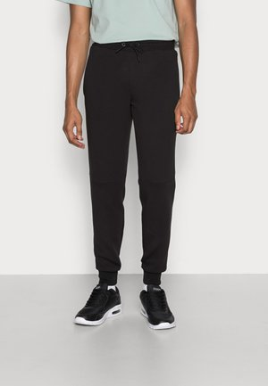 FIRST MILE JOGGER PANTS - Tracksuit bottoms - puma black