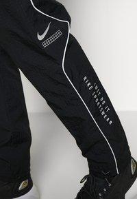 Nike Sportswear - Teplákové kalhoty - black - 5