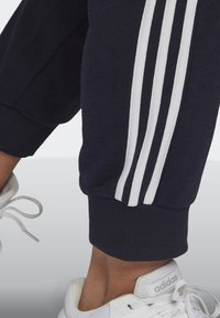 adidas Performance - ADIDAS ESSENTIALS FRENCH TERRY 3-STRIPES PANTS (PLUS SIZE) - Tracksuit bottoms - legink/white - 4
