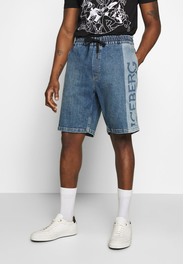 BERMUDA  - Denim shorts - indaco