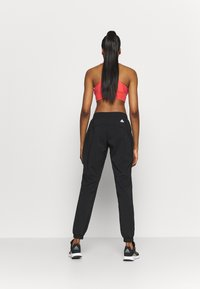 adidas Performance - BOS PANT - Pantalones deportivos - black/white - 2