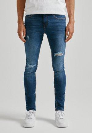 Jeans Skinny - mottled dark blue