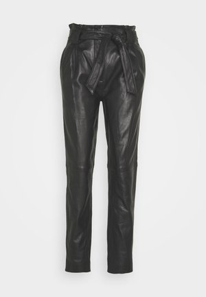 SAGO TROUSERS - Leather trousers - black