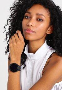 Polar - M200 - Smartwatch - black - 1