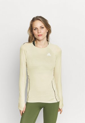 ADI RUNNER - Sports shirt - sand