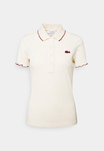 Polo shirt - naturel clair/pinot