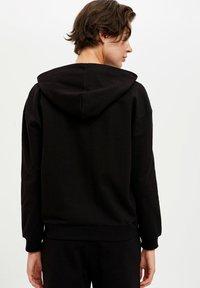 DeFacto Fit - Jersey con capucha - black - 2
