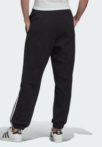 adidas Originals - FLEECE PANT ADICOLOR ORIGINALS RELAXED PANTS - Tracksuit bottoms - black - 1