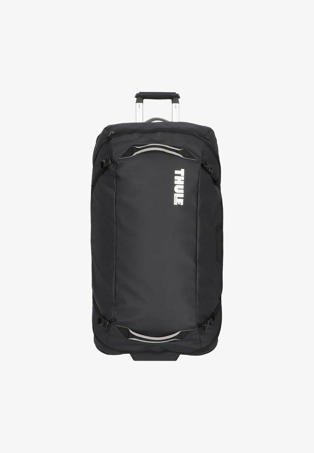 CHASM  - Wheeled suitcase - black