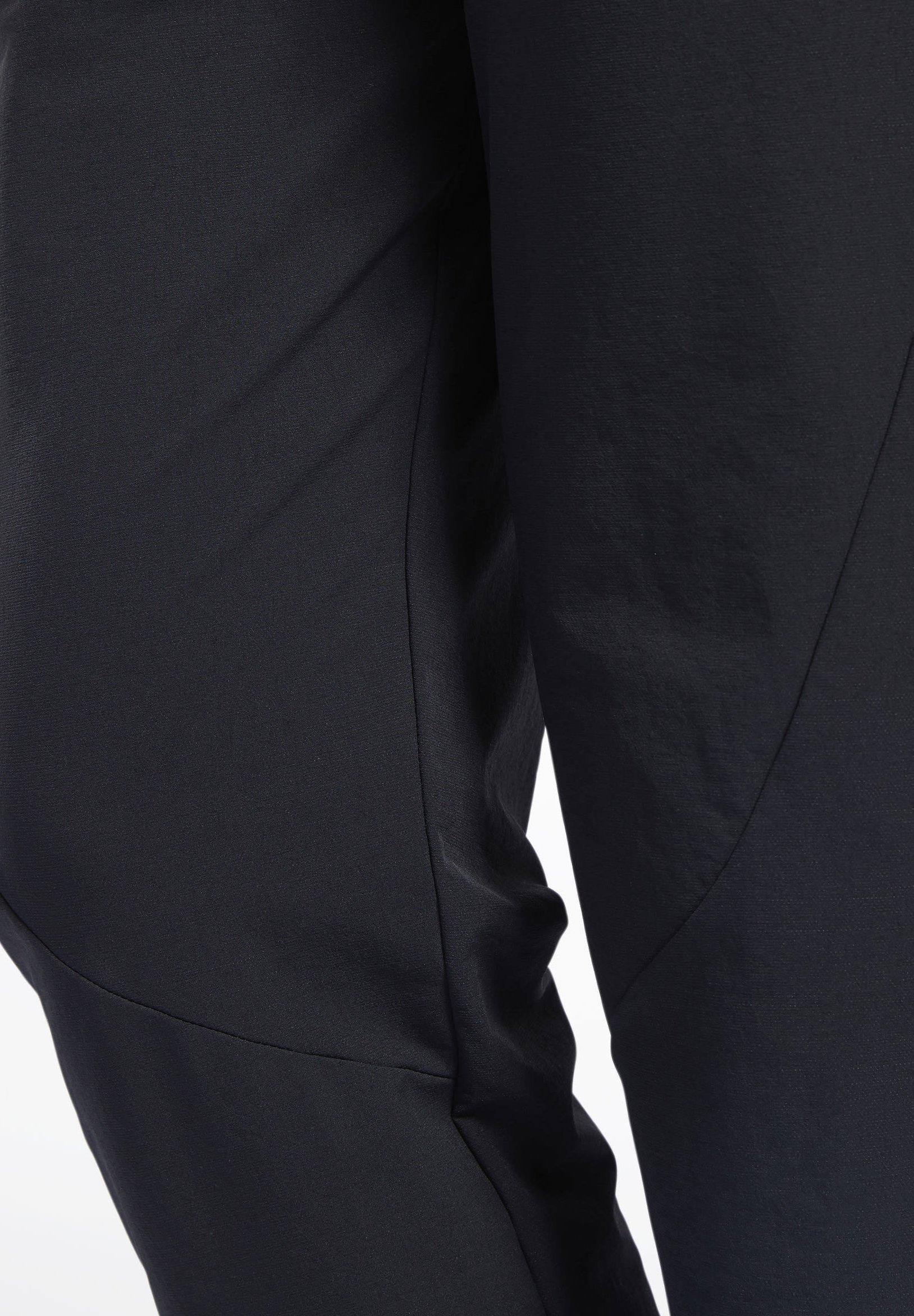 Reebok STRETCH WOVEN JOGGERS - Tracksuit bottoms - black fBWwl