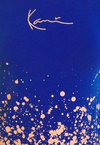 Karl Kani - SMALL SIGNATURE PAINT SPLATTER SHORT TEE - Print T-shirt - blue - 7