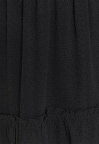 Moss Copenhagen - AYELLA SKIRT - A-linjainen hame - black - 2