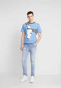 Diesel - TEPPHAR-X - Slim fit jeans - light-blue denim - 1