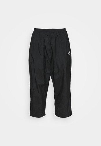 AIR PANT - Tracksuit bottoms - black/white