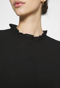 Vero Moda - VMZIGGA FRILL - Shirt dress - black - 5